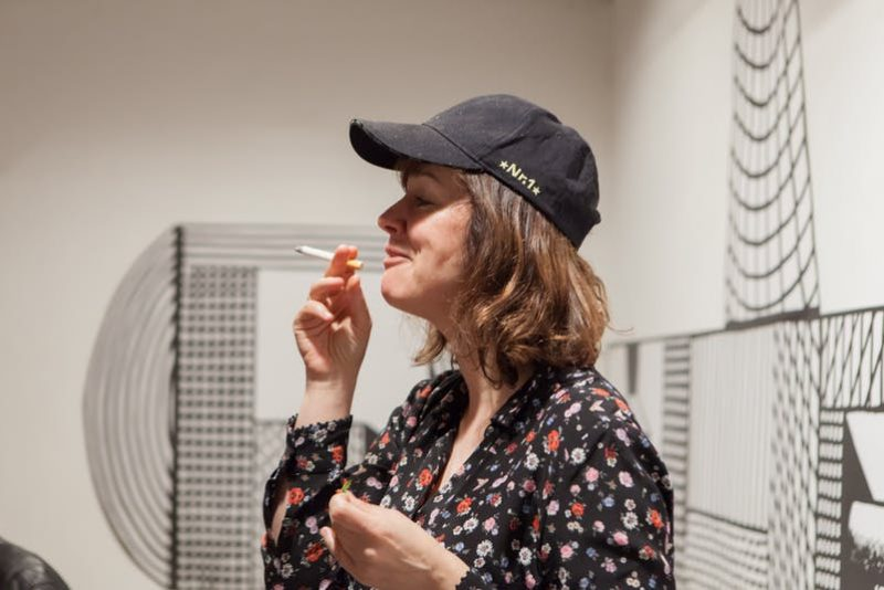Nicole Wermers with a ceramic cigarette of Rio Grande after preparing breakfast
